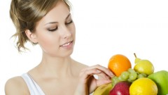 (girl eating fruits (shutterstock
