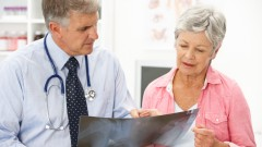 (doctor with a woman patient (shutterstock